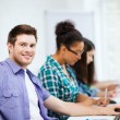 Student with computer studying at school — Stock Photo #63933621