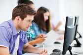 Student with computer studying at school — Stock Photo