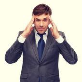 Stressed buisnessman or teacher having headache — Stock Photo