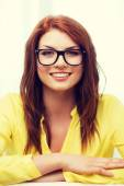Smiling teenage girl in eyeglasses at home — Stock Photo