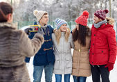 Happy friends taking picture with smartphone — Stock Photo