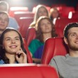 Happy friends watching movie in theater — Stock Photo #64246321