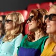 Happy friends watching movie in 3d theater — Stock Photo #64246343