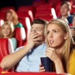 Friends watching horror movie in theater — Stock Photo #64246347