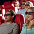 Friends watching horror movie in 3d theater — Stock Photo #64246363