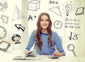 Student girl with book, notebook and calculator — Stock Photo