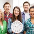 Group of students at school with clock — Stock Photo #64756227