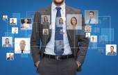 Close up of businessman over icons with contacts — Stock Photo