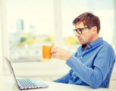 Man working with laptop at home — Stock Photo