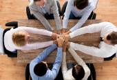 Close up of business team with hands on top — Stock Photo