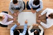 Close up of business team with paper at table — Stock Photo