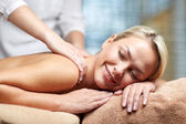 Close up of woman lying and having massage in spa — Stock Photo