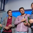 Group of male friends with beer in nightclub — Stock Photo #65169413