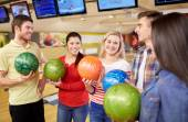 Happy friends in bowling club — Stockfoto