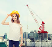 Smiling little girl in protective helmet — Stock Photo