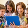 Group of kids with teacher and tablet pc at school — Stock Photo #65376891