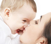 Mother kissing her baby — Stock Photo