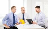 Happy team of architects and designers in office — Stock Photo