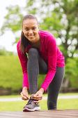 Smiling woman exercising outdoors — Stock Photo