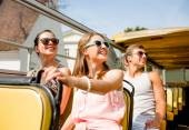 Group of smiling friends traveling by tour bus — Stock Photo