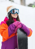 Happy young woman with snowboard outdoors — Stock Photo