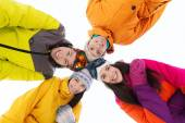 Happy friends in ski goggles outdoors — Stock Photo