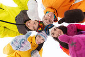 Happy friends in winter clothes outdoors — Stock Photo