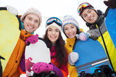 Happy friends with snowboards — Stock Photo
