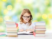 Happy student girl reading book at school — Stock Photo