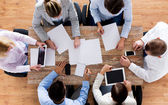 Close up of business team with papers and gadgets — Stock Photo