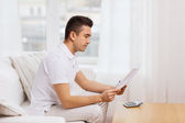 Man with papers and calculator at home — Stock Photo