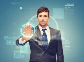 Attractive buisnessman wotking with virtual screen — Stock Photo