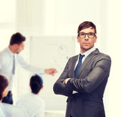 Attractive buisnessman or teacher in glasses — Stock Photo