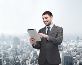 Smiling buisnessman with tablet pc computer — Stock Photo