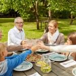 Happy family having dinner in summer garden — Stock Photo #66006495
