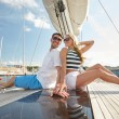 Smiling couple sitting on yacht deck — Stock Photo #66006607