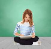 Happy little student girl with tablet pc — Stock Photo