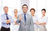 Happy businessman in suit showing thumbs up — Stock Photo