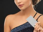 Woman in evening dress with plastic card — Stock Photo