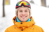 Happy young man in ski goggles outdoors — Stok fotoğraf