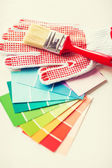 Paintbrush, gloves and pantone samplers — Stock Photo