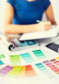 Woman working with color samples for selection — Stock Photo