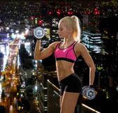 Sporty woman with heavy steel dumbbells — Foto de Stock