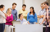 Group of students and teacher with laptop — Stockfoto
