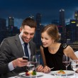 Couple on romantic date in restaurant — Stock Photo #66812257