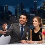Couple on romantic date in restaurant — Stock Photo #66812333