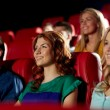 Happy friends watching movie in theater — Stock Photo #66817559