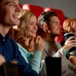 Happy friends watching movie in theater — Stock Photo #66817627