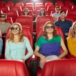 Friends watching movie in 3d theater — Stock Photo #66817659