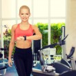 Sporty woman working out in gym — Stok fotoğraf #66819043